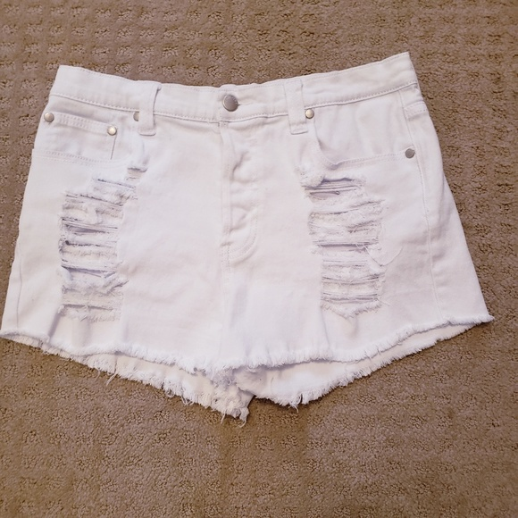 MINKPINK Pants - Mink Pink white distressed shorts size L.
